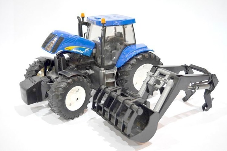 Bruder 03021 traktor New Holland z ładowaczem 24h